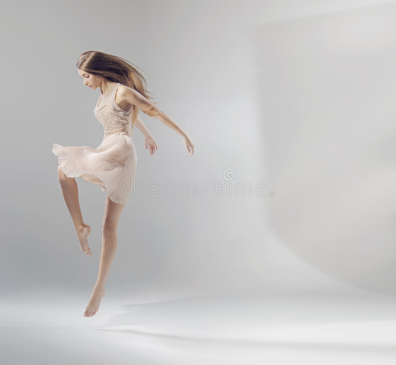 Talented young jumping ballet dancer royalty free stock photos