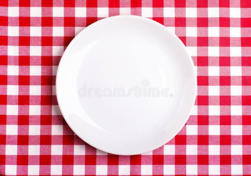 Talerz Na Tablecloth Fotografia Stock