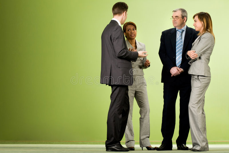 Talk. Portrait of several smart associates talking to each other after meeting or conference stock photo