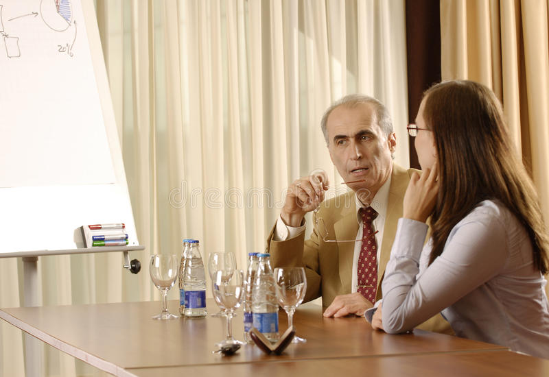 Talk with a boss. Young business woman have talk with boss royalty free stock photography