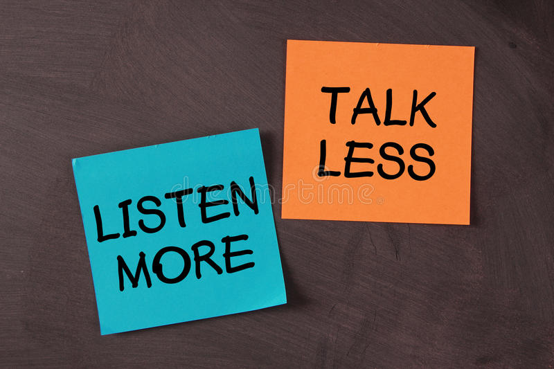Talk Less and Listen More. 'Talk Less and Listen More' notes pasted on blackboard stock image