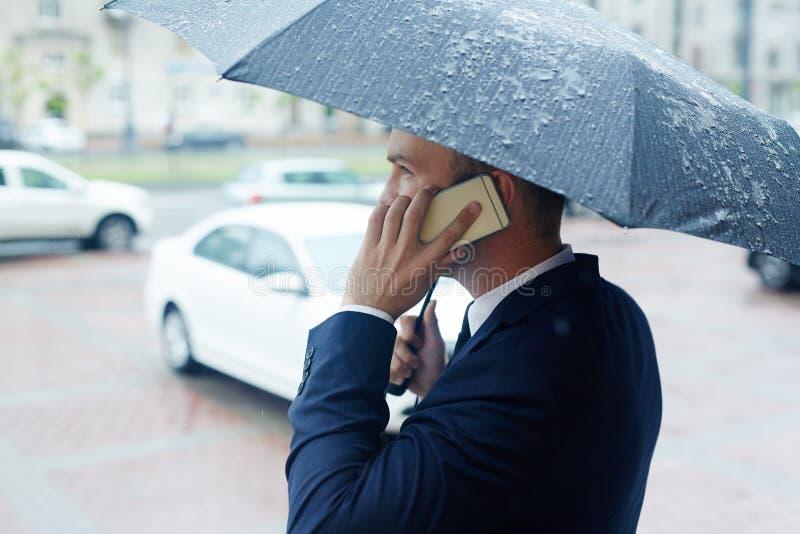 Talk in the rain stock image