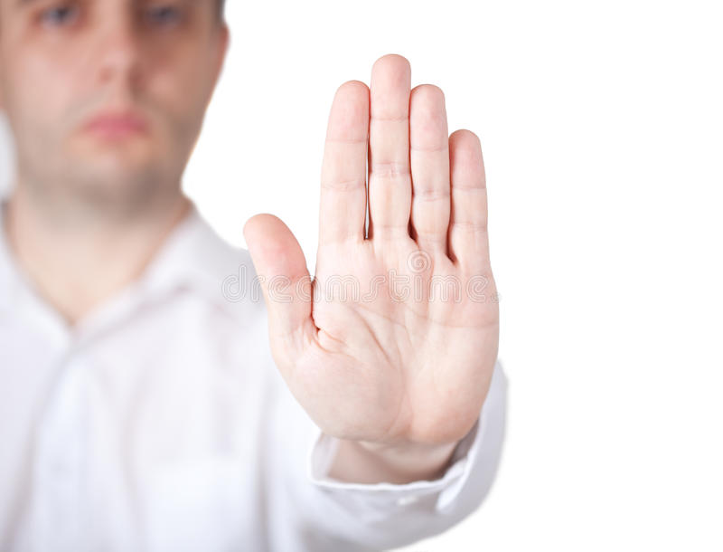 Talk to the hand. Man in white shirt holding hand out in the stop gesture. Clipping path royalty free stock photography