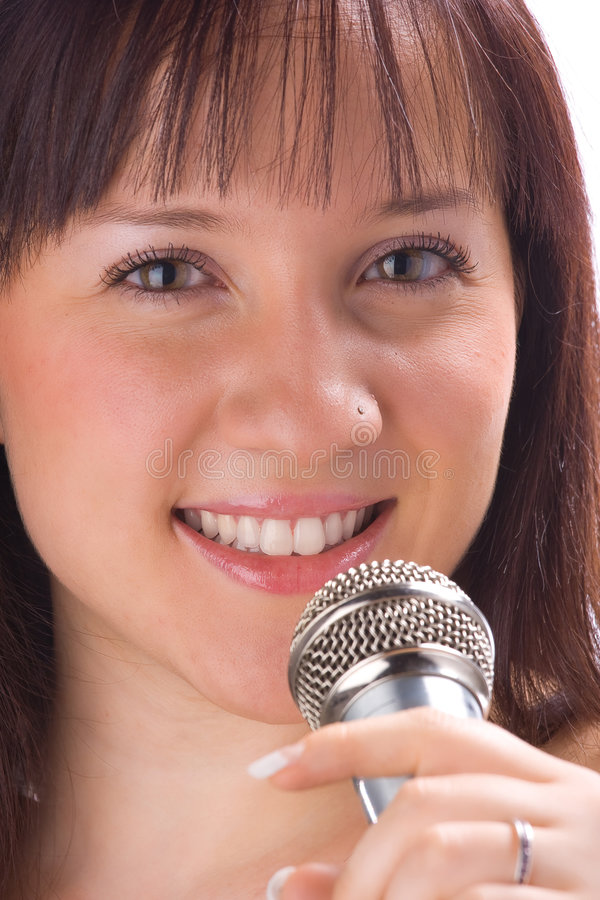 Talk to the mic. Girl talking with a mic in white background stock images
