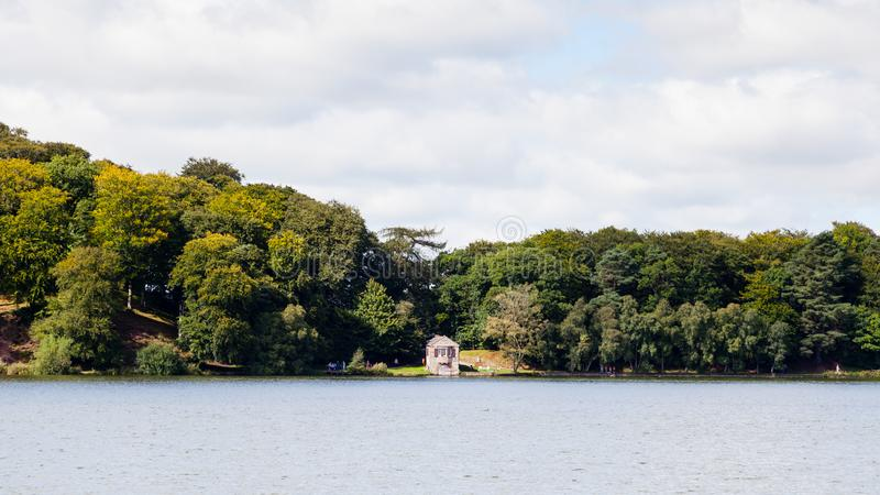 Talkin Tarn. The view across Talkin Tarn, Cumbria in northern England. The tarn is a glacial lake and country park close to the town of Brampton royalty free stock photography