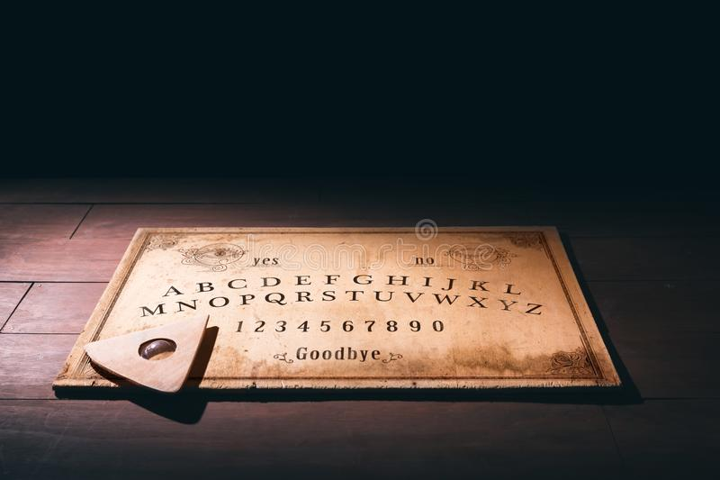 Talking board and planchette stock image