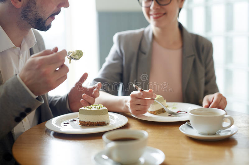 Talking by dessert royalty free stock images