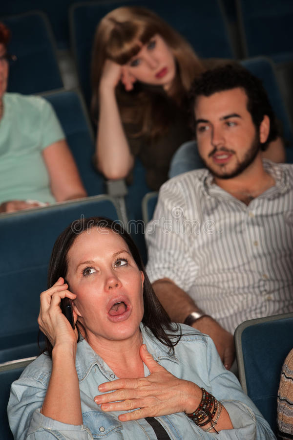 Free Talking Loudly In A Theater Stock Photos - 23577223