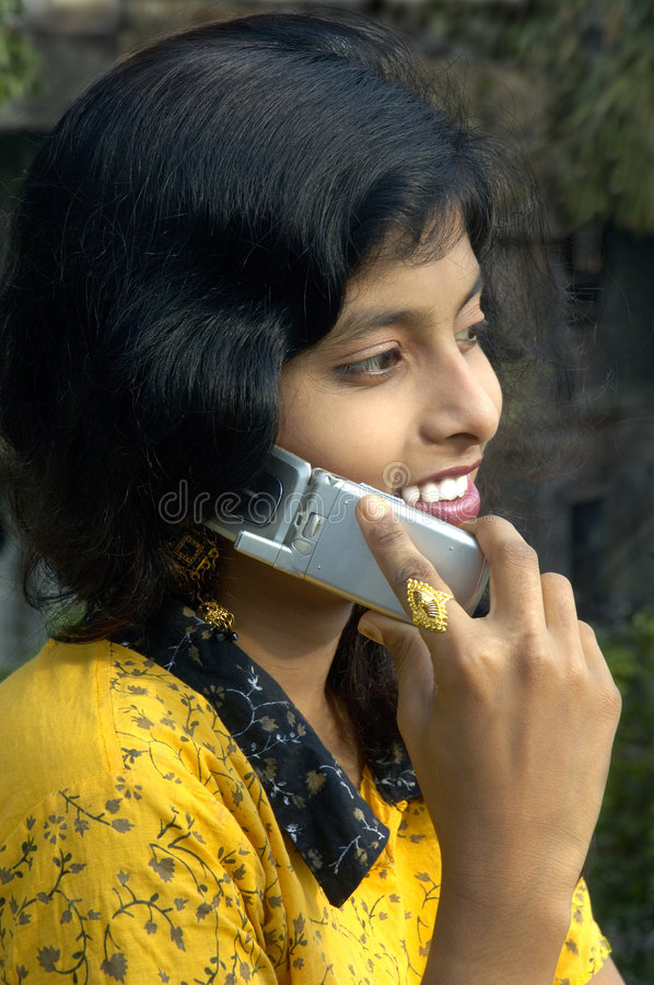 Talking at a mobile phone. stock image
