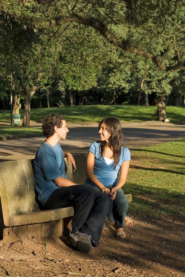 Talking on a Park Bench-Vertical stock photos