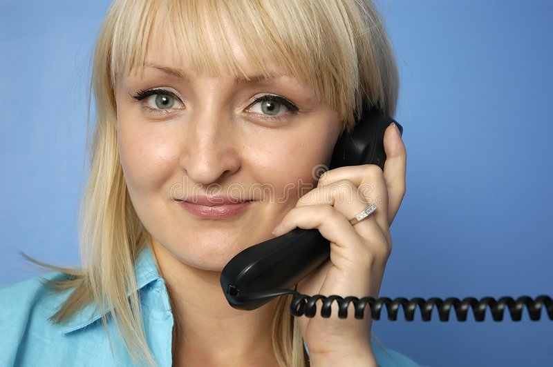 Talking by phone stock image