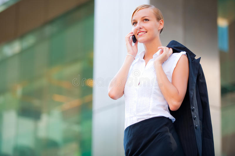 Talking on the phone stock images