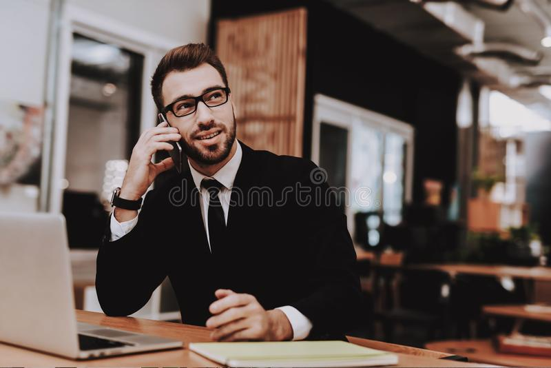 Talking on Phone. Business Suit. Project. Laptop stock photo