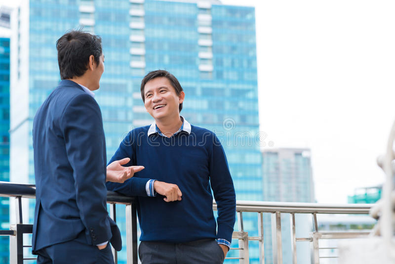 Talking and smiling royalty free stock photos