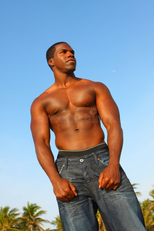 Tall Bodybuilder Flexing Muscles royalty free stock images