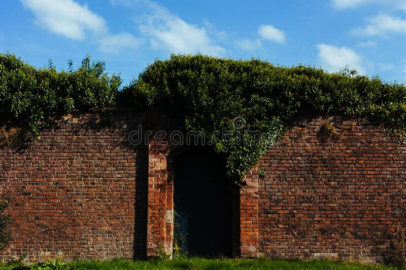 Tall Brick Wall With Closed Garden Gate Free Public Domain Cc0 Image