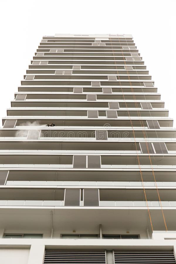 A tall building being washed in Auckland, NZ. royalty free stock image