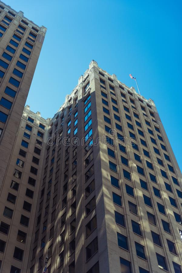 Tall building in a Chicago Downtown with an American flag on a r royalty free stock image