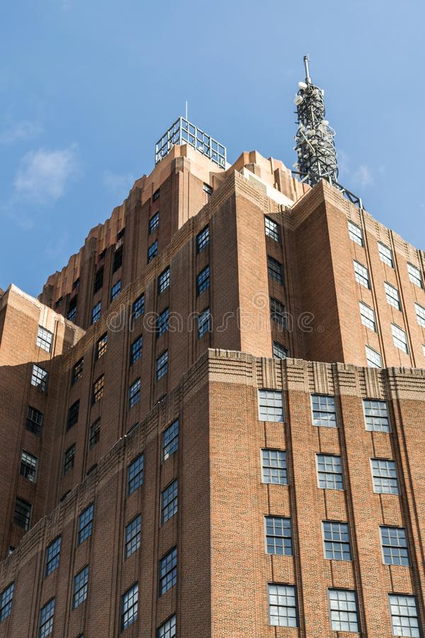 Tall building in Downtown Manhattan, with metal antennae structure on the roof, New York City, NY. Tall building in Downtown Manhattan with metal antennae royalty free stock photos