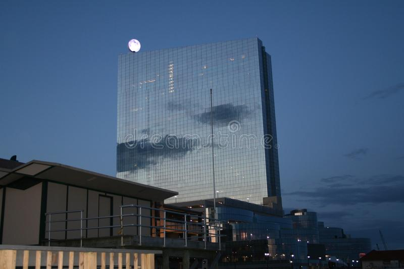 Tall Building Moon At Evening Royalty Free Stock Image