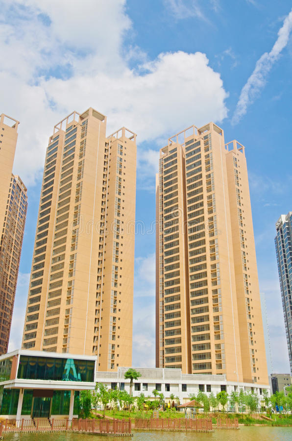Tall building. The new high-rise under blue sky royalty free stock images