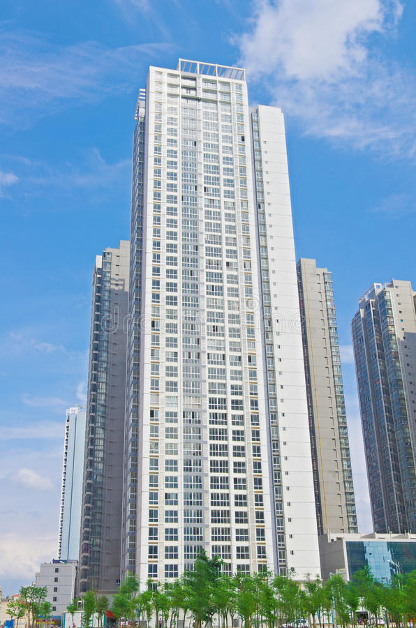 Tall building. The new high-rise under blue sky stock image