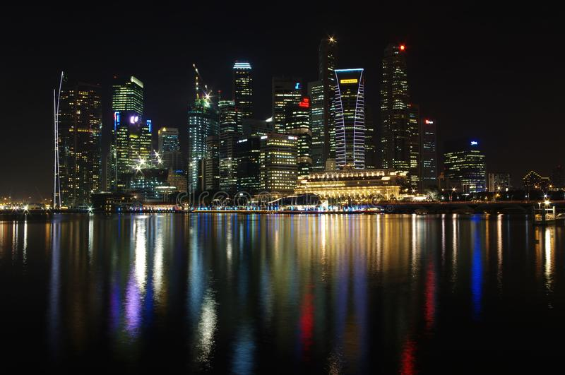 Tall buildings at Singapore Marina bay area in CBD during night time royalty free stock photography