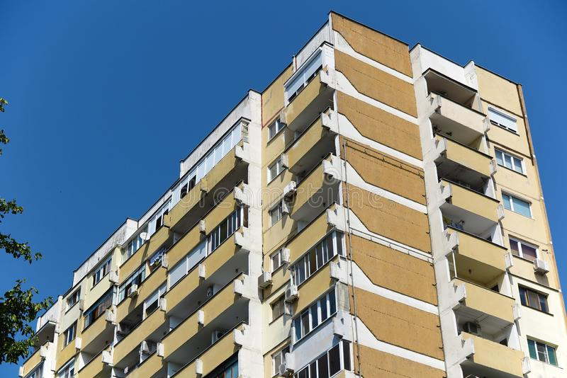 Bulgarian communist apartment block building. Tall Bulgarian communist apartment block building on blue sky royalty free stock image