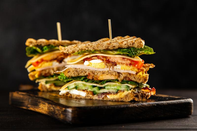 Tall club sandwich. With eggs, turkey and bacon royalty free stock photography