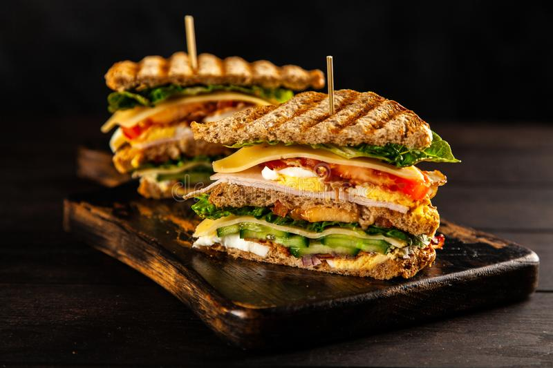 Tall club sandwich. With eggs, turkey and bacon stock image