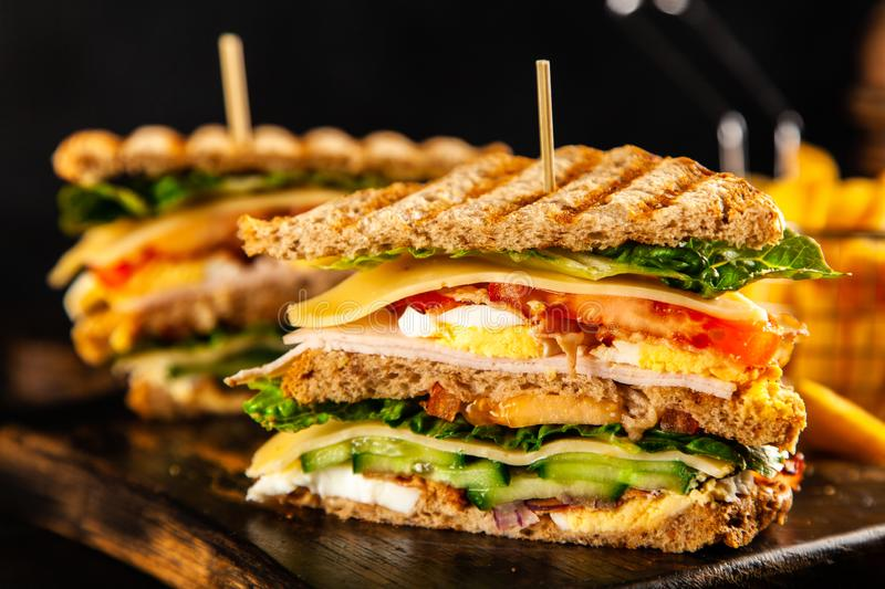 Tall club sandwich. And french fries stock photo