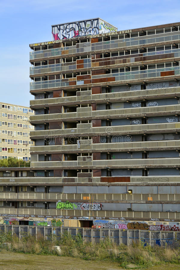 Tall Concrete Social Housing Block Boarded Up Prior To Demolition Stock Images