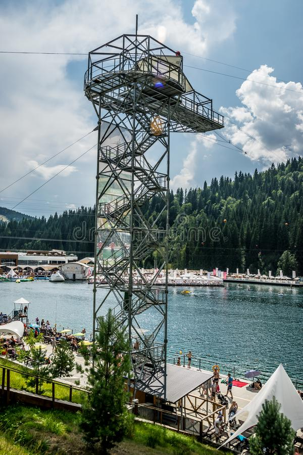 Tall diving tower on the lake in Bukovel stock images