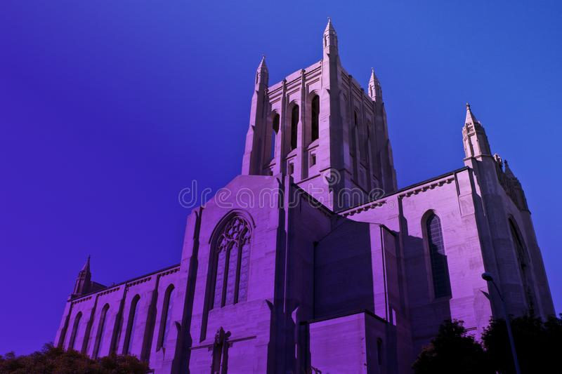Tall downtown Los Angeles Catholic Church in twilight purple haze. Twilight with a purple haze at the historic downtown Los Angeles Catholic Church