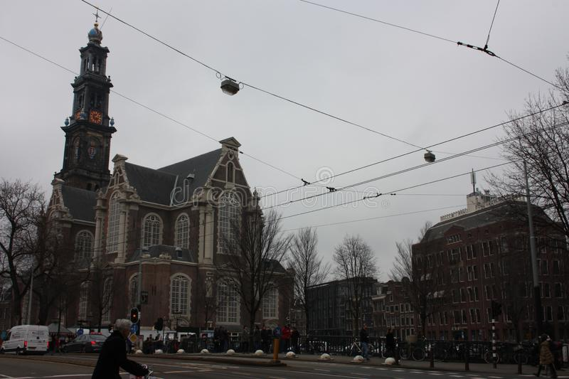 Tall Dutch buildings built in red bricks in the style of Amsterdam. cold autumn day, gray and cloudy.  royalty free stock photography