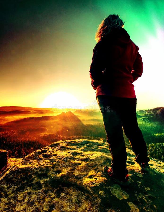 Tall girl tourist enjoy successful achievement of summit stock photography