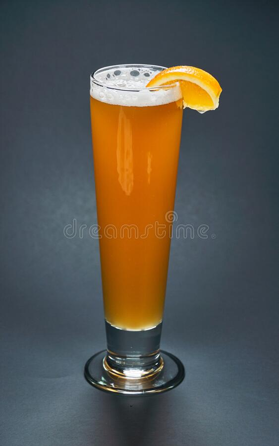 Free Tall Glass Of Unfiltered White Beer With A Sclice Of Orange On It Over A Black Background Royalty Free Stock Photography - 176006607