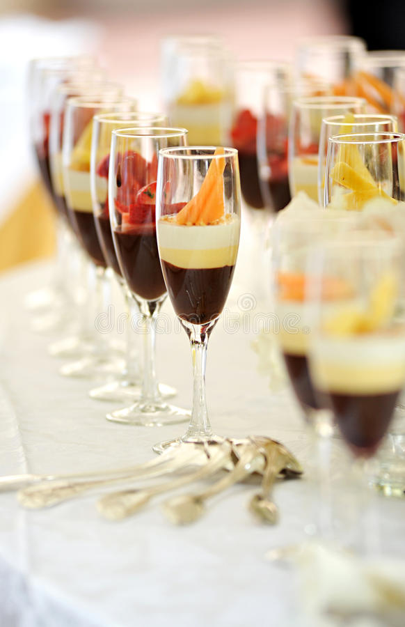 Tall glasses of assorted chocolate cream desserts stock photo