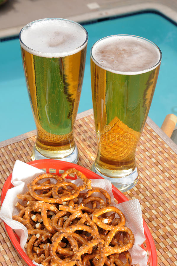 Download Tall Glasses Of Beer By The Pool Stock Photo - Image: 26280370