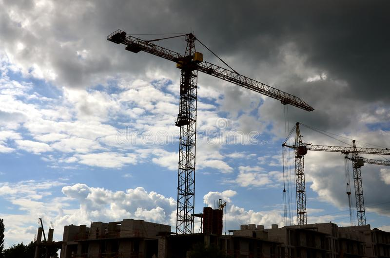 Tall and heavy construction crane towers against a blue sk. Y stock photography