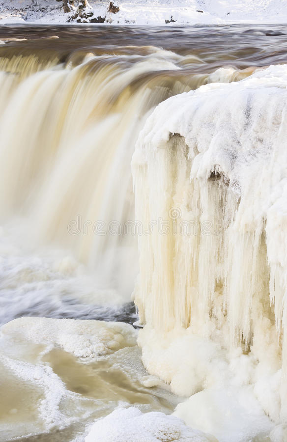 Tall icicles on waterfall royalty free stock image
