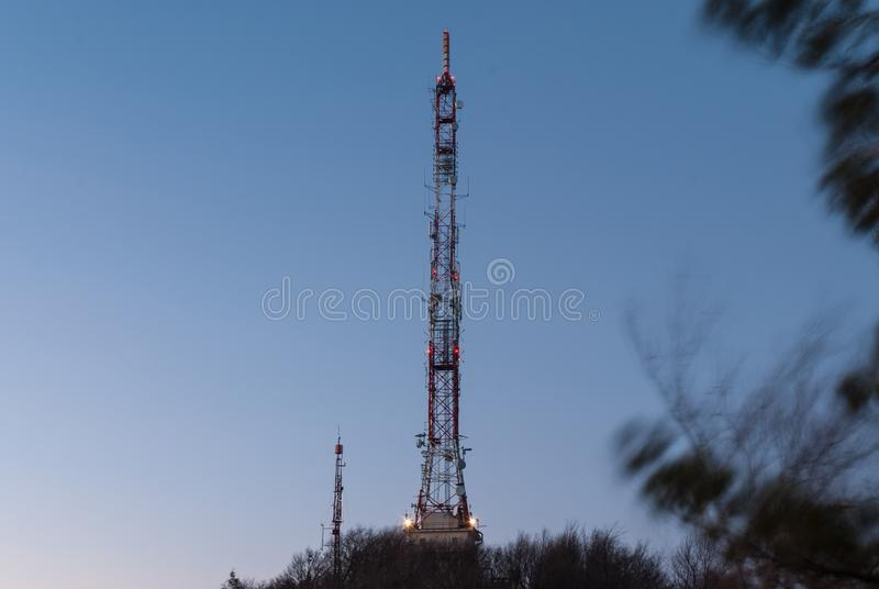 Tall telecommunication tower at night royalty free stock photography