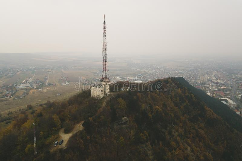 Tall lattice telecommunication tower. On a mountain in Piatra-Neamt city stock images