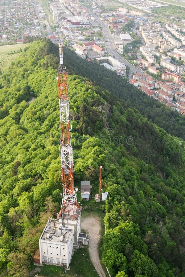 Tall lattice telecommunication tower. On a mountain in Piatra-Neamt city stock photos