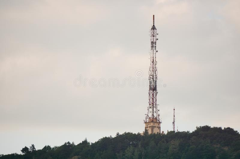 Tall lattice telecommunication tower on mountain. With microwave antennas royalty free stock images