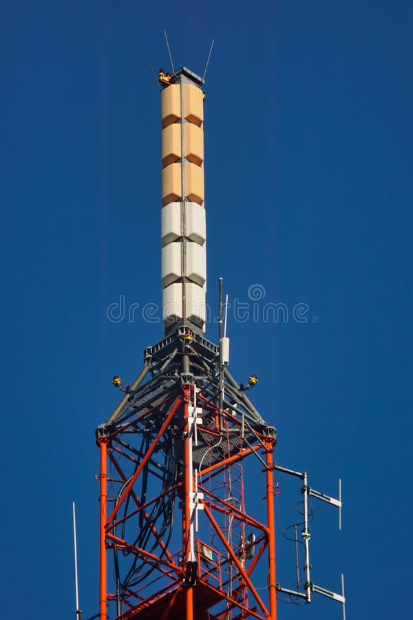 Tall lattice telecommunication tower. With antennas royalty free stock photos