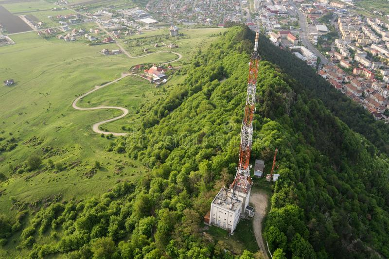 Tall lattice telecommunication tower. On a mountain in Piatra-Neamt city royalty free stock images