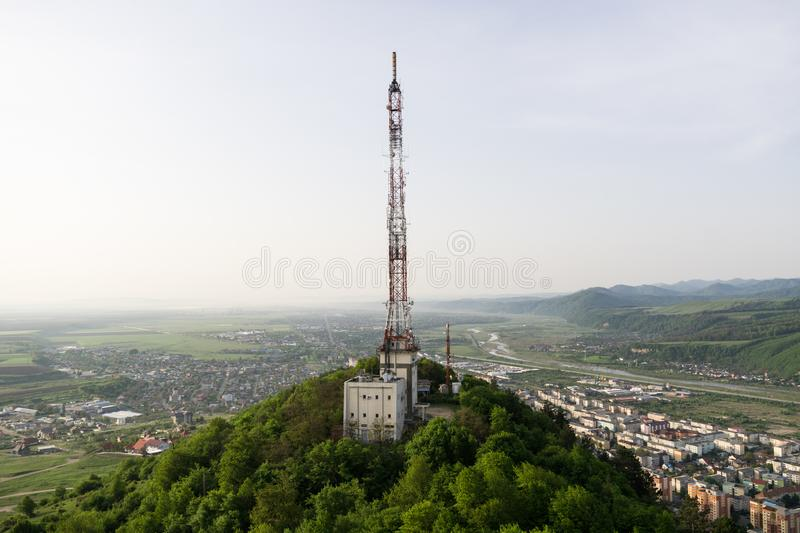 Tall lattice telecommunication tower. On a mountain in Piatra-Neamt city stock photography