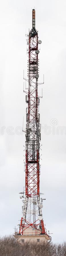 Tall lattice telecommunication tower. On a mountain in Piatra-Neamt city royalty free stock image