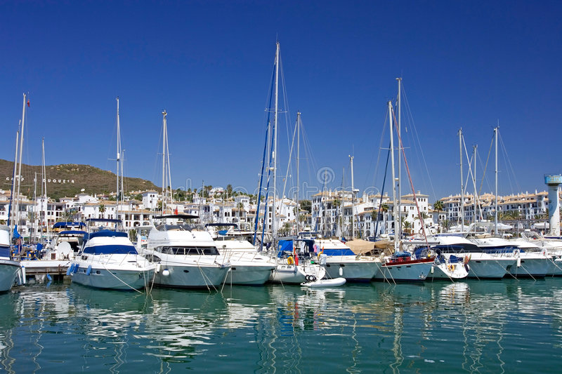 Tall luxury boats and yachts moored in Duquesa port in Spain on royalty free stock photo